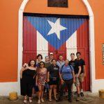 group posing flag door background
